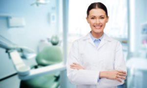dental professional smiling at camera
